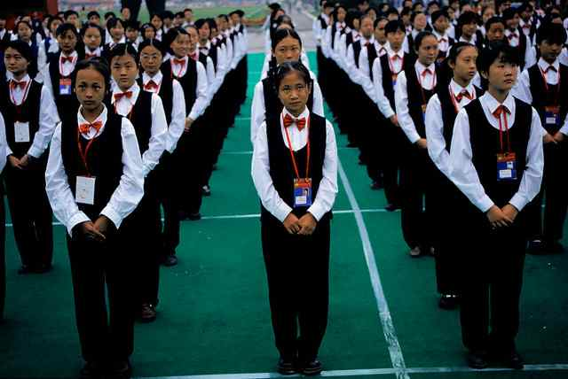 Students in School Uniforms Standing in Formation